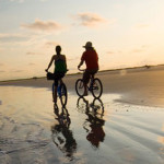 Ride bicycles on the beach
